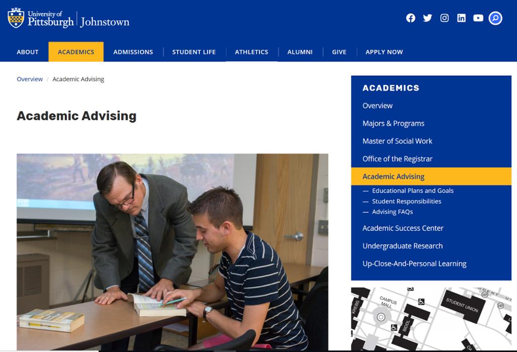 Screenshot of Johnstown Advising Page with picture of professor helping a student