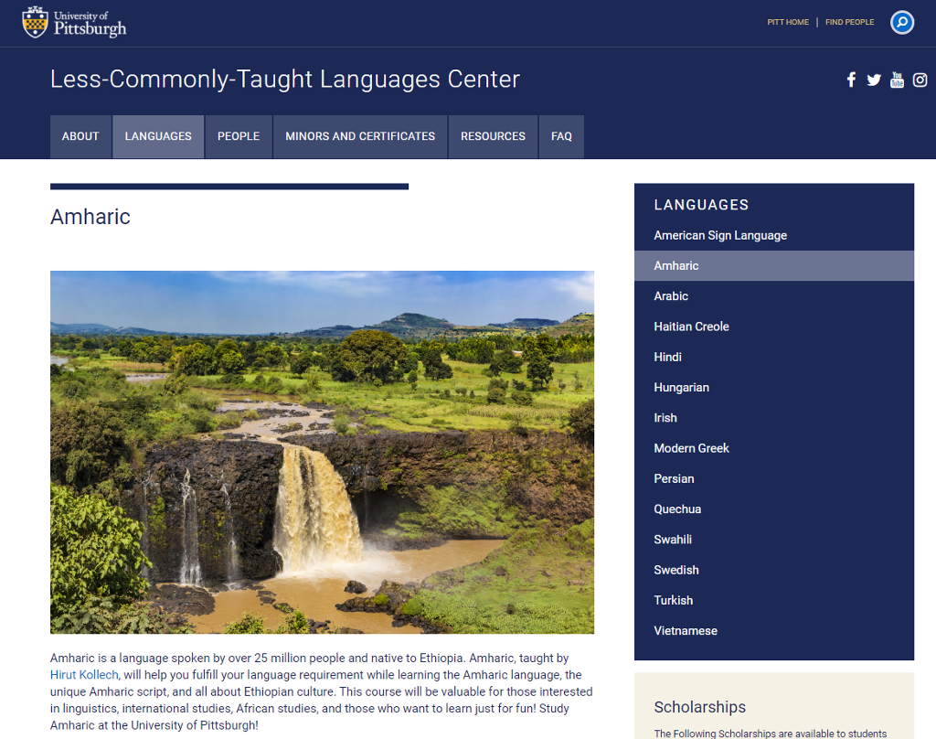 A screen shot showing the Amharic language page. A picture shows a waterfall in Ethiopia surrounded by plant life.