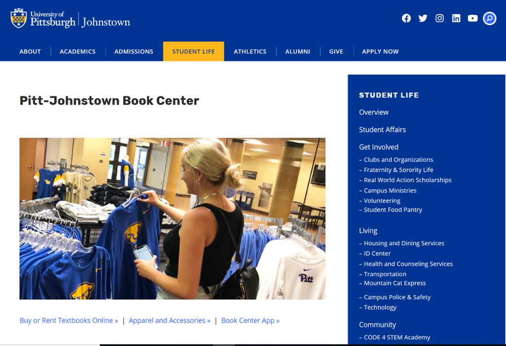 Screenshot of Book Center Johnstown Page with picture of woman shopping for shirts